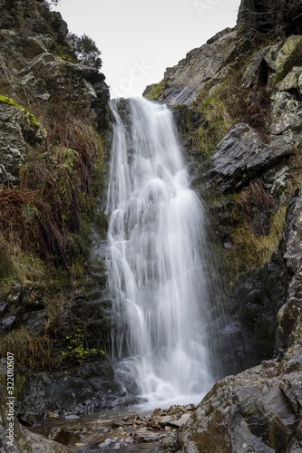 Vertical shot of a Risco Waterfall in Lombo, Portuga