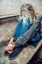 Blonde Girl With Her Hands Tie...