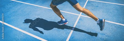 Leinwand Poster Sprinting man runner sprinter athlete running shoes and legs on track and field lane run race competing fast panoramic banner background