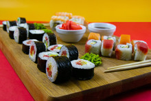 Top View Of Wooden Platter With Great Set Of Delicious Nigiri Sushi And Tempura Rolls With Maki And Uramaki Rolls