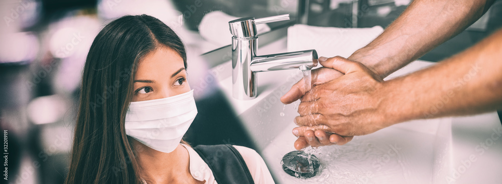 Fototapeta Coronavirus Wuhan China outbreak Asian chinese woman wearing face mask versus man washing hands in hot water rubbing in soap panoramic banner.