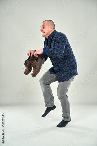 Fotografía Man sneaking around tiptoeing