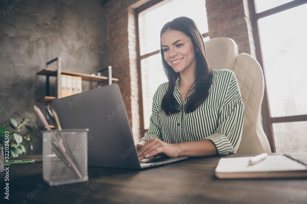Fototapeta Photo of attractive latin business lady notebook table chatting colleagues read corporate report wear striped shirt sitting chair modern interior office indoors