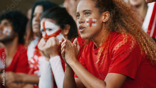 Fototapeta Group of English football team supporters in stadium obraz