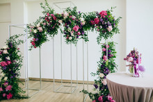 Beautiful Wedding Arch In The Restaurant Decorated With Fresh Pink And Purple Flowers