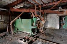 Broken Malt Equipment At An Abandoned Brewery