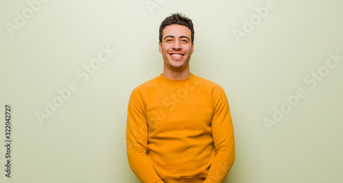 young arabian man looking happy and goofy with a broad, fun, loony smile and eye Canvas Print