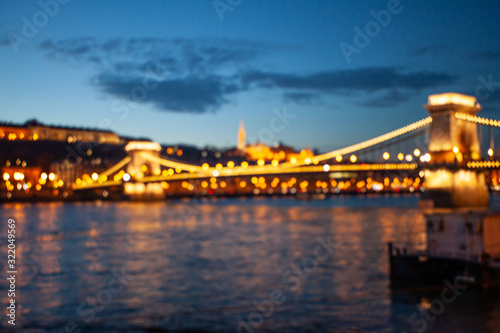 Fototapety, obrazy: Blurred Budapest chain bridge on danube river. Famous sights at landmark Buda riverbank.