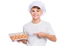 Happy Teen Boy In Chef Hat Hol...