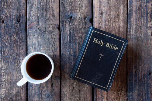 Black bible on a wooden table Canvas Print