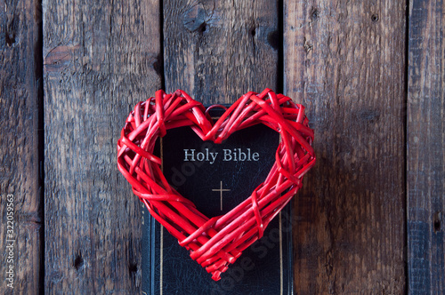 Red heart on a black bible Canvas Print