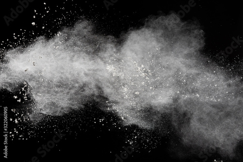 White powder explosion isolated on black background.White dust particles splash. - 322060905
