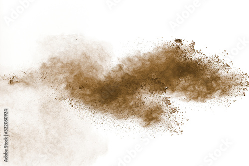 Obraz Abstract deep brown dust explosion on white background.Freeze motion of brown dust splash. - fototapety do salonu