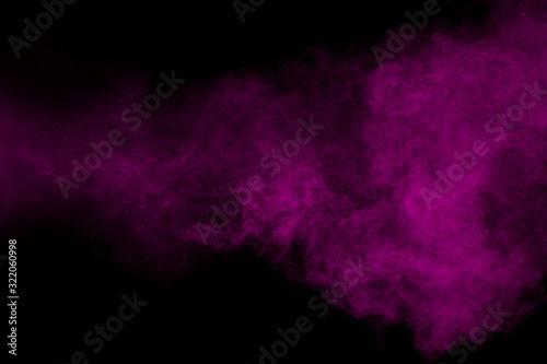 Fotografía Purple color powder explosion cloud  on black background