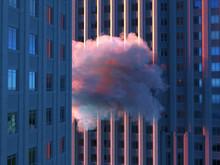 Pink Cloud Between Skyscrapers