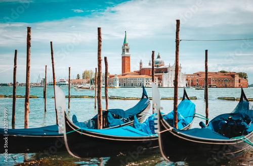 Venice, Italy. Close up of Gondolas and San Giorgio Maggiore church on Grand Canal in background