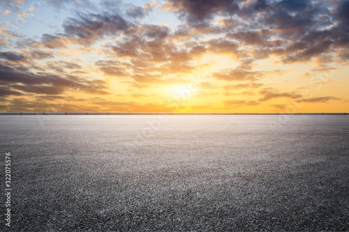 Leinwand Poster Empty asphalt road and sunset sky landscape in summer
