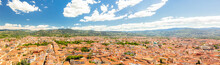 Beautiful Panoramic View Of Florence City Aerial Skyline - Towers, Basilicas, Red-tiled Roofs Of Houses And Mountains On Cityscape, Florence, Tuscany, Italy