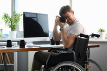 Male Disabled Photographer Hol...
