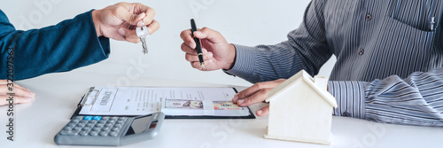 Fototapeta Sale representative offer house purchase contract to buy a house or apartment or discussing about loans and interest rates. obraz