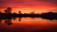 Blazing Sunset Glow Over The Lake