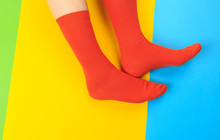 Legs In Colorful Socks On Colo...