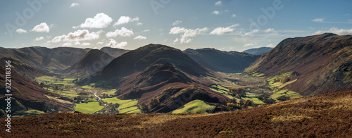 Fototapeta Majestic Autumn Fall panorama landscape image of Sleet Fell and Howstead Brow in Lake District with beautiful early morning light in valleys and on hills obraz