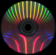 Scratched Dvd Disc On A Black Background