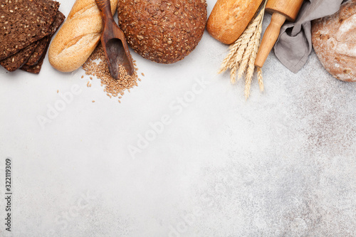 Various bread with wheat, flour and cooking utensils