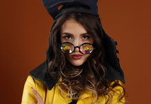 A Girl In A Leather Motorcycle Helmet And Kaleidoscope Glasses