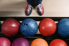 Person In Bowling Shoes Near R...