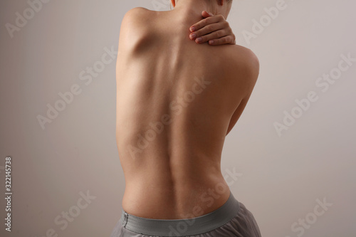Photo Woman with back pain, Scoliosis spine curve