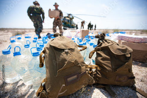 Fototapeta Delivery of humanitarian aid by military helicopter obraz