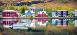 Panoramic morning cityscape of small fishing town - Seydisfjordur. Calm summer scene of east west Iceland, Europe. Traveling concept background.