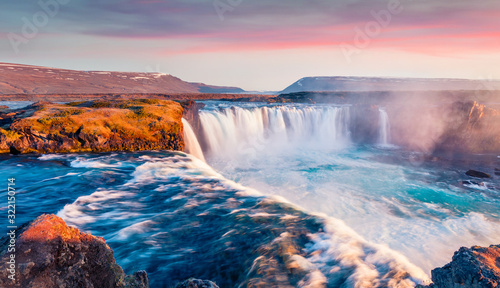 Spectacular sunrise on Skjalfandafljot river, Iceland, Europe. Magnificent summer view of Godafoss waterfall. Travel to Iceland..