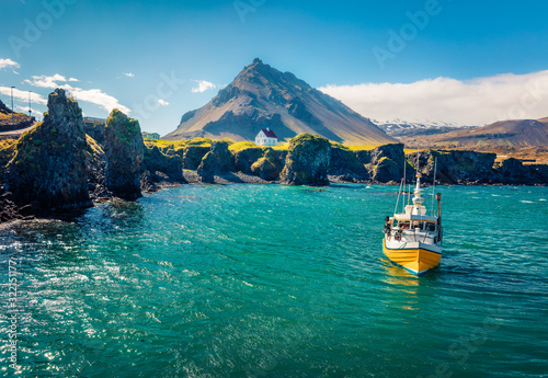 Picturesque morning view of small fishing village at the foot of Mt Canvas Print
