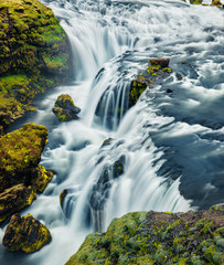 Fototapeta Wodospad Splendid morning view of waterfall on Skoga river. Green summer view from the tourist trek from famous Skogafoss waterfall to the top of the river. Beautiful morning scene of Iceland, Europe.