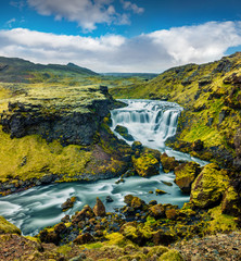Fototapeta Wodospad Splendid summer scene of waterfall on Skoga river. Stunning summer view from the tourist trek from famous Skogafoss waterfall to the top of the river. Picturesque morning scene of Iceland, Europe.
