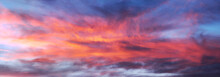 The Bright Fiery Colors Of Sunset In The Mountains Are A Beautiful Sight. Red Clouds Can Be Used As Background In Digital Processing.