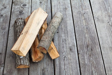 Firewood Logs Lying On Square-...