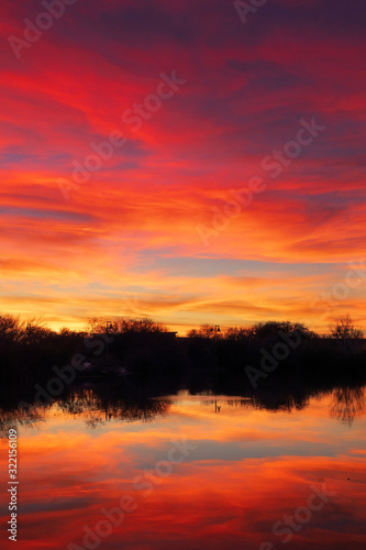 Colorful sunset sky over a lake