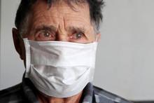 Elderly Man In Medical Mask Lo...