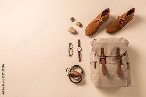 Obraz Men's accessories - camel shoes, khaki backpack and leather belt - fototapety do salonu