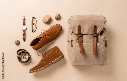 Obraz Men's accessories - camel shoes, khaki backpack and leather belt - fototapety do salonu