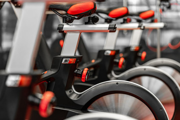 Stationary Spinning bicycles. Indoor cycling for lifestyle design. Fitness background. Healthy lifestyle background. Spinning class with empty bikes. Sport background. Sport, recreation, lifestyle