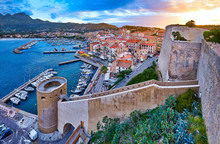 View From The Walls Of The Citadel Of Calvi On The Old Town With Historic Buildings At Evening Sunset. Bay With Yachts And Boats. Luxurious Marina Popular Tourist Destination. Corsica, France.