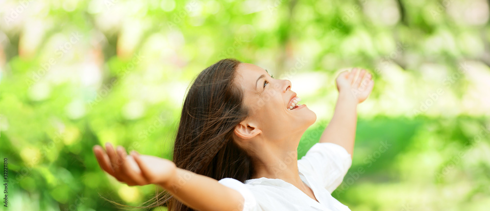 Fototapeta Happy clean air Asian woman breathing in fresh outdoor nature forest panoramic banner for allergy free pollen allergies.