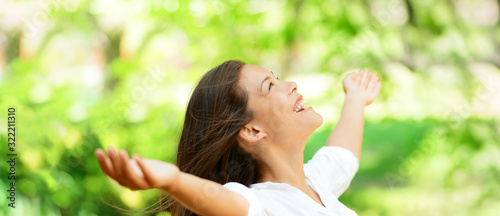 Fototapeta Happy clean air Asian woman breathing in fresh outdoor nature forest panoramic banner for allergy free pollen allergies