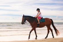 Kids Riding Horse On Beach. Ch...