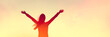 Leinwanddruck Bild - Happy woman sihouette with arms raised up in success on sunset glow sunshine banner panorama. Wellness, financial freedom, healthy life concept background.